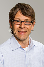 A headshot of theory and composition professor Dr. Dan Pinkston