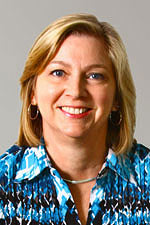 A headshot of Spanish professor Debora Rager