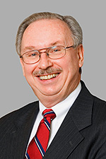 A headshot of Simpson University Board of Trustee member Alan Burchett