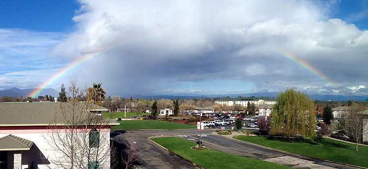 A rainbow arcing over Simpson's campus after a storm