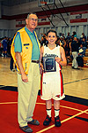 Archer Pugh of the Lions Club gives a MVP award to All-Star Ashley Rothmann of Foothill High School
