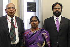 From left, Dr. Solomon Raju, his wife, Jessy Raju, and their son, Dr. Solomon Darwin stand in front of an office dedicated to Dr. Raju inside Simpson University's new Science and Nursing Center