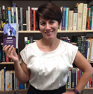 On the Same Page organizer, Dr. Nicole Kinely, holds a copy of Frankenstein