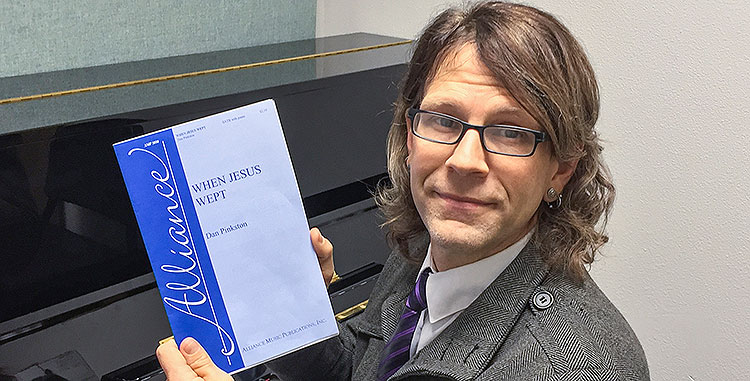 Dr. Dan Pinkston holds a copy of his new published composition